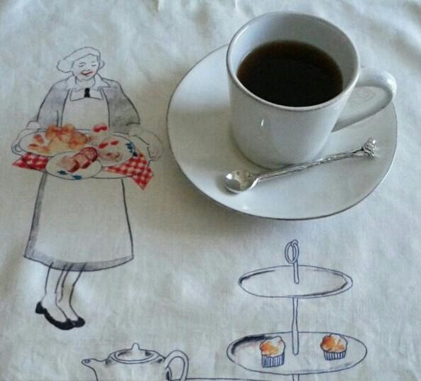 カップのコーヒーそしてティタオル